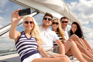 http://www.dreamstime.com/royalty-free-stock-photography-smiling-friends-sitting-yacht-deck-vacation-travel-sea-friendship-people-concept-making-selfie-image42833277